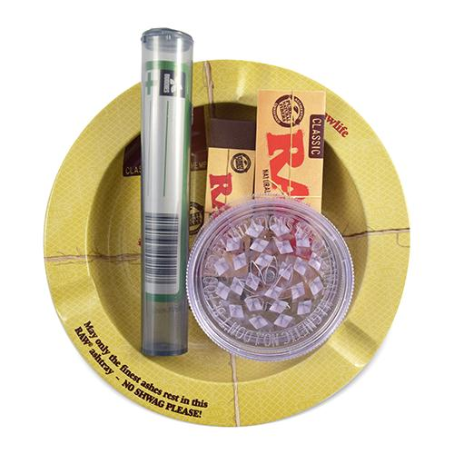 "ACCESSORY STARTER KIT by RAW Kit includes Raw 1 ¼"" papers, Raw tips, Raw ashtray, cone tube, and a plastic grinder."